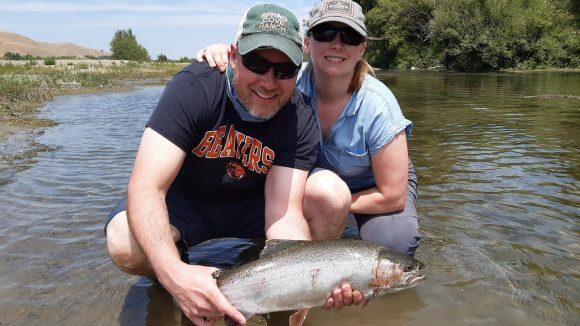 John and McKinzie fly fishing Tukituki River