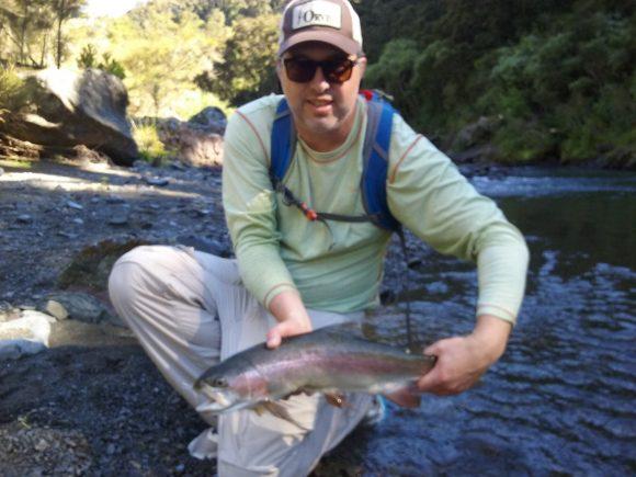 Phil Reynolds hooking Hawkes Bay rainbow trout..
