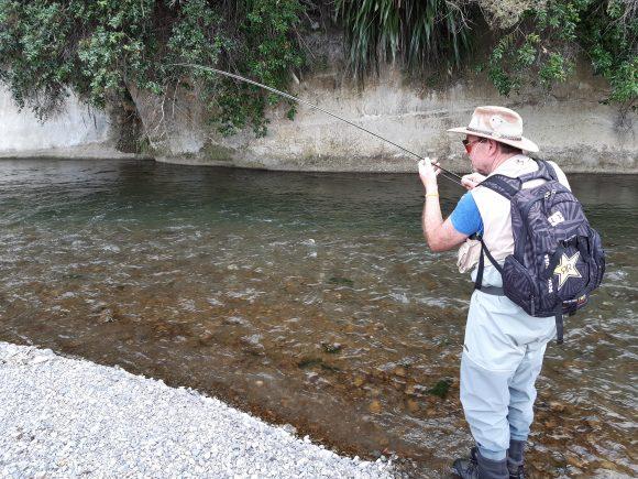 Klaus Gretzmacher, the happy camper, fly fishing Hawkes Bay NZ.