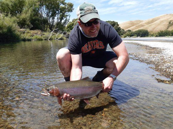 John and McKinzie enjoying Tukituki rainbow trout.
